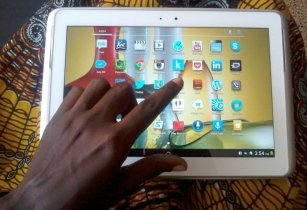 Ghanaian using a tablet